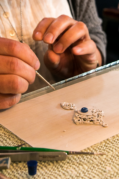 close up of artist making a pendant